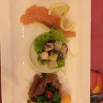 House marinated salmon, octopus salad with new potatoes in Italian vinaigrette, Parma ham colise