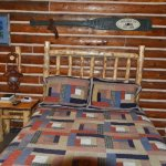 Comfortable bed in rustic setting.