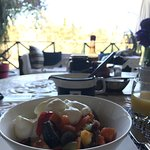 Exceedingly tasty breakfast on the covered terrace and view from our room's balcony