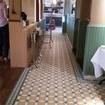 The new floor tiles and green-painted wood in the dining area.