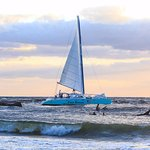 Palm Breeze Surf Sailing out Boca Inlet