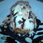 Brownies with Ice Cream and Almond Flakes