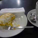 Delicious lemon meringue and coffee after lunch