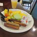 Fresh fruit and sausage from the complimentary breakfast buffet.