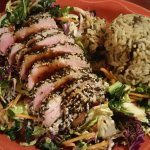 Seared Ahi Tuna encrusted with sesame on bed of Kale Salad, wild rice mix on side. Stella's Barn