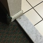 Carpeting coming up and we tripped on this marble step from room into bathroom area more than on