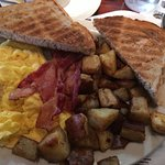 Go hungry. The food offers large portions. I loved the rye bread  toast and the eggs were just r