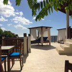 Lunch tables and cabana near the pool