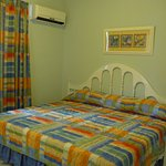 King bed in bedroom and AC