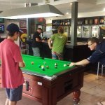 A friendly game of pool in our main bar