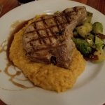 Thick cut pork chop on risotto