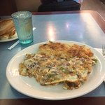 Cheesesteak omelet with home fries.