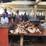 Cooking some fish to sell at the fish market