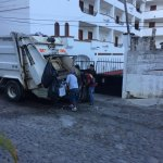Noisy garbage men digging through Tropicana trash 7 am each morning