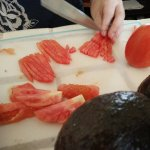 Slicing tomatoes.