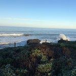 Surf crashing from the boardwalk of Moonstone Beach