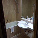 small traditional bathroom but with a great range of toiletries and extras