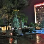 View of pool and bar at night