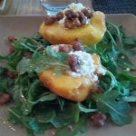 Best grilled peach and goat cheese salad I EVER had! It's seasonal selection in August!