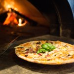 We use native hardwoods for our wood-fired pizza oven! Delicous!