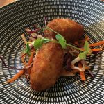 Entree of pulled pork croquette with a slaw