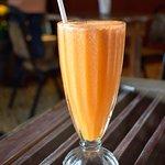 Jugo fresca natural- Orange, pineapple, and carrots