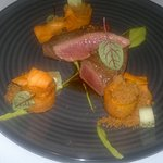 Backstrap of lamb, 1 inch cubes of sweet potato, pea and mint puree