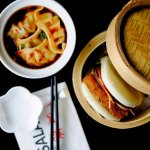 Steamed bun of roasted pork belly & pickled cucumber and Pork & chive dumplings with red chilli