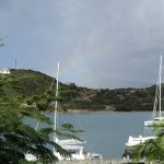 View from room of bay with rainbow