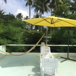 Hammock, seating, and umbrella provided in the private rooftop area