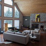 Comfortable great room with fireplace and a wall of windows.