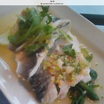 Sea bass poached in herbs with lime & chilli