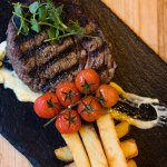 28 day aged ribeye of Blackgate beef skin on rooster chips vine tomatoes aioli, credit John John