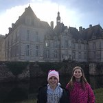 our daughters in front of the moat that surrounds the Chateau and the Keep