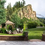 Summer views of the cliffs, river, arbor and fire pit