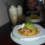 This is photo of my meal(nachos) and my drink(iced latte)