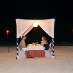 Romantic dinner on the beach, outside of the steakhouse