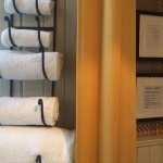 Fluffy white bath sheets in The Heron private bathroom.