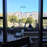 View from the breakfast buffet, the pool area and your evening dining veranda view!