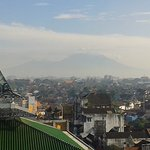 Gunungs Merapi and Merbabu - and a new mosque being built right in front - will this be noisy?