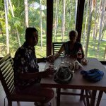 Dugong Restaurant with a view of tall tress all around, SeaShell Hotel, Neil Island, Andaman.