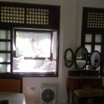 windows, couch, and electric fan
