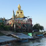 Buddha in Boat next to Mekong River