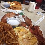 French Toast with Bacon, Eggs and Hashbrowns in the front and Sweet Potato Pancakes in the back