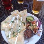Menu and tasty Quesadilla