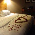 rose petal arrangement on bed