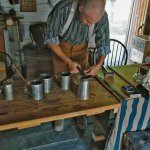 The tinsmith working in his shop
