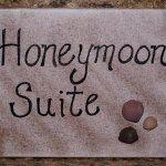 The Honeymoon Suite features a queen bed