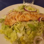 Salmon with butter & garlic over Caesar Salad