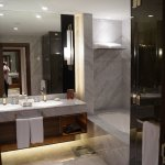 Twin sinks, large shower with 2 shower head, plenty of towels provided plus robes and hair dryer